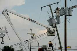 Linemen work on several utility poles along Phelan Boulevard in Beaumont Monday. Photo taken Monday, September 7, 2020 Kim Brent/The Enterprise
