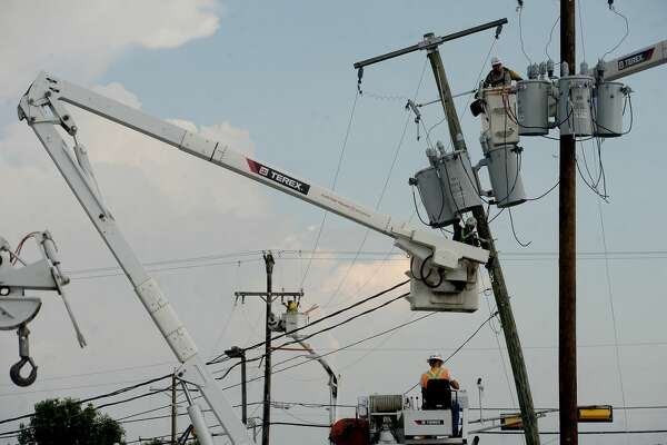 Linemen work on several utility poles along Phelan Boulevard in Beaumont Monday. Photo taken Monday, September 7, 2020 Kim Brent/The Enterprise