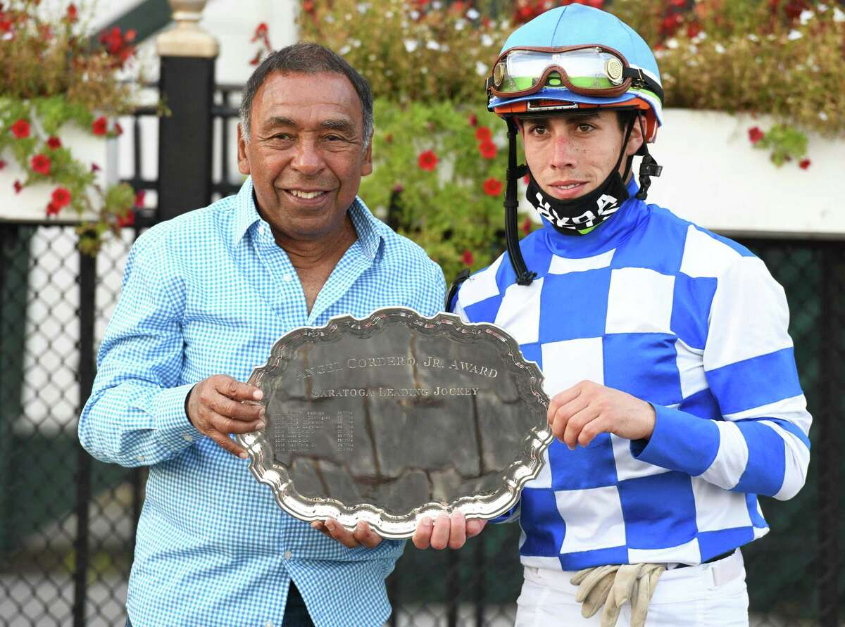 Hall of Fame jockey Angel Cordero Jr. presents the award honoring his accomplishments to Irad Ortiz, Jr. the top rider at the Spa meet for the third time on Monday, September 7, 2020 at Saratoga Race Course in Saratoga Springs, N.Y. (Mike Kane/Special to the Times Union)