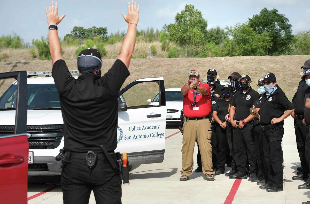 San Antonio College law enforcement instructor Gary Mound shows students how to execute a felony traffic stop at the school's First Responders Academy.