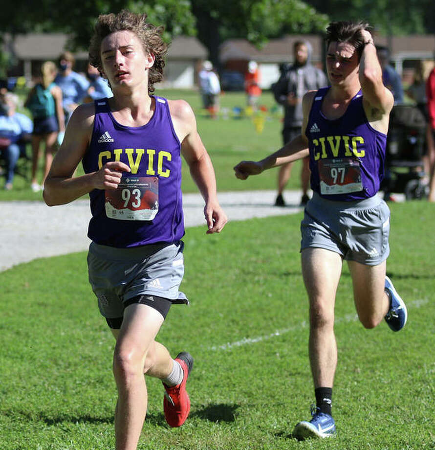 CM's Aslan Henderson (left) and Evan Zobrist run together during Saturday's Granite City Invite at Wilson Park. Both were among the six Eagles that PRs in the boys cross country race. Photo: Greg Shashack / The Telegraph