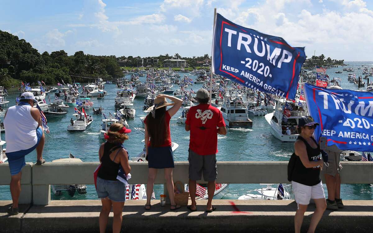 People watch from the bridge as boaters show their support for President Donald Trump at the start to a parade down the Intracoastal Waterway to just off the shore of President Trump's home at Mar-a-Lago on September 07, 2020 in West Palm Beach, Florida.
