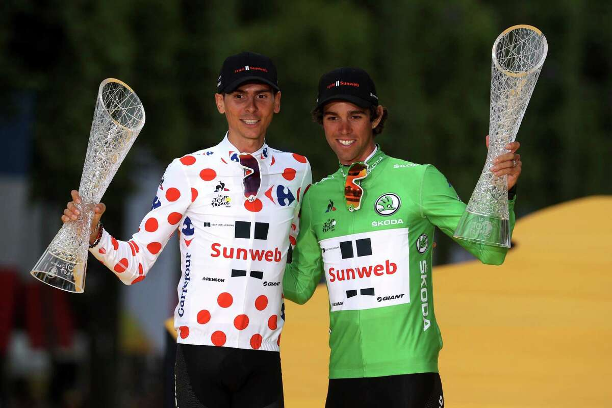 PARIS, FRANCE - JULY 23: Warren Barguil of France riding for Team Sunweb in the king of the mountains jersey and Michael Matthews of Australia riding for Team Sunweb in the points jersey pose for a photo on the podium after stage 21 of the 2017 Le Tour de France, a 103km stage from Montgreon to the Paris Champs-A‰lysA©es on July 23, 2017 in Paris, France. (Photo by Chris Graythen/Getty Images) ORG XMIT: 687111297