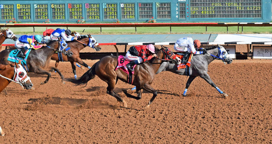 Whistle Stop Cafe finishes ahead of Instygator during Monday's running of the All American Futurity at Ruidoso Downs Race Track & Casino. Photo: Ruidoso Downs Race Track & Casino