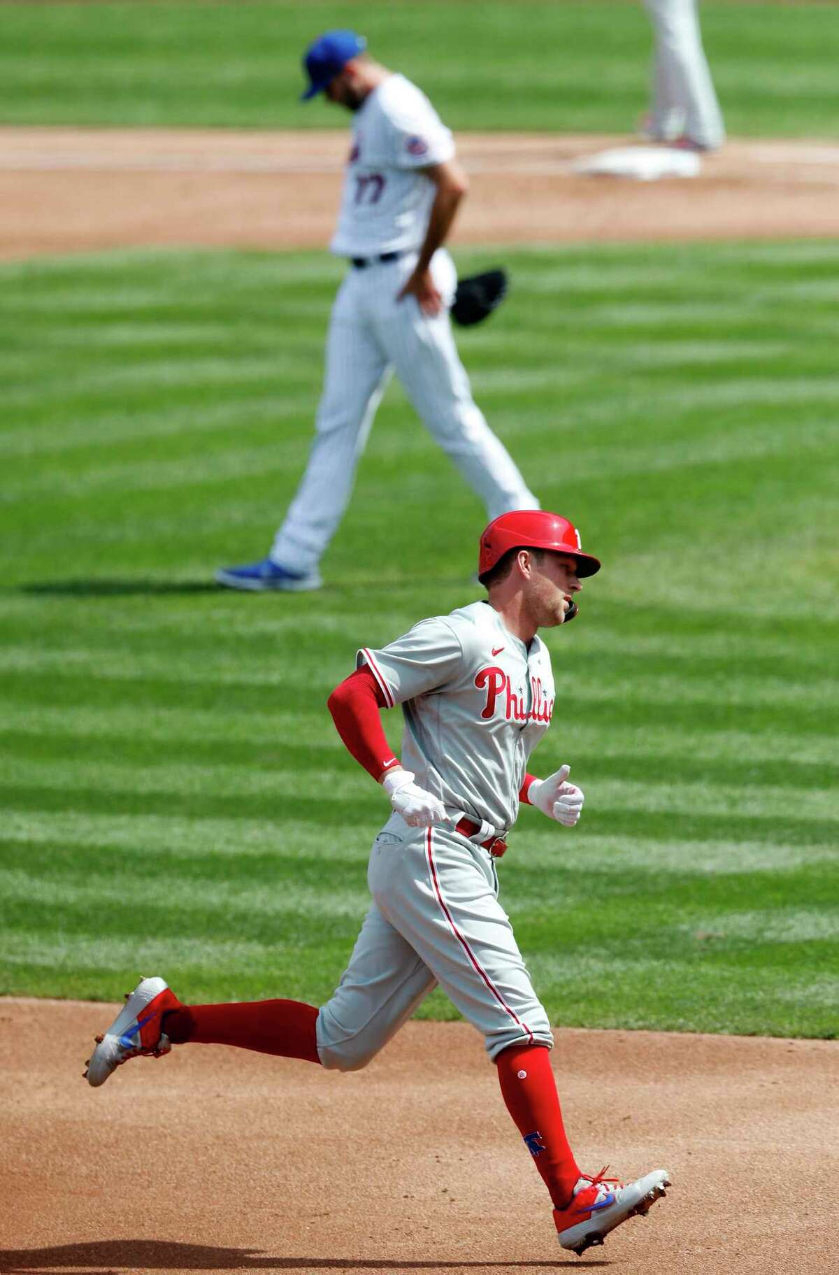 NEW YORK, NEW YORK - SEPTEMBER 07: Rhys Hoskins #17 of the Philadelphia Phillies runs the bases after his second-inning two-run home run against David Peterson #77 of the New York Mets at Citi Field on September 07, 2020 in New York City. (Photo by Jim McIsaac/Getty Images)
