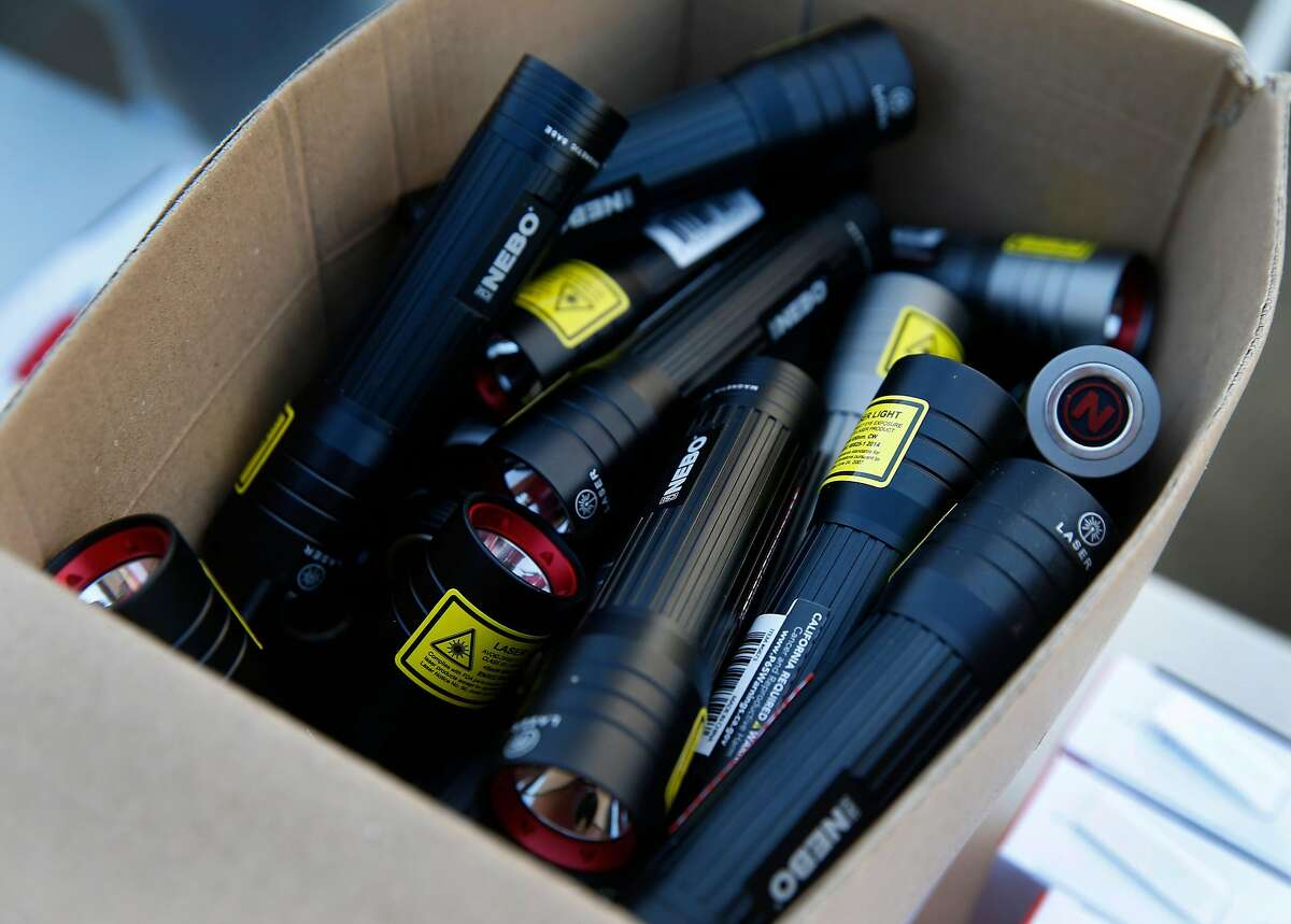 High powered flashlights are distributed to residents affected by the extended power outage at the PG&E community resource center at the Solano County Fairgrounds as the public safety power shutoff issued by the utility company continues for a third consecutive day in Vallejo, Calif. on Tuesday, Oct. 29, 2019.