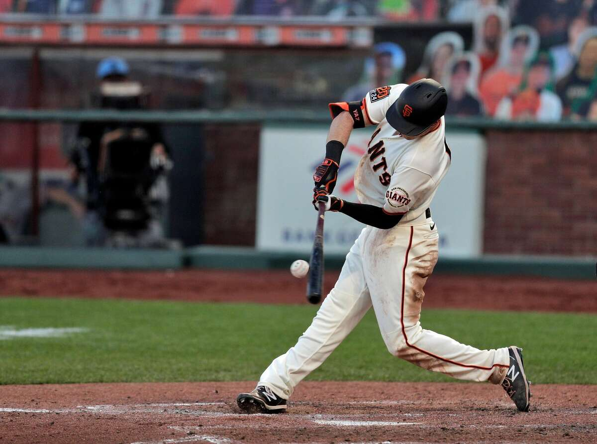 Mike Yastrzemski (5) connects for a single that scored the tying run in the sixth as the San Francisco Giants played the Arizona Diamondbacks at Oracle Park in San Francisco Calif., on Monday, September 7, 2020.