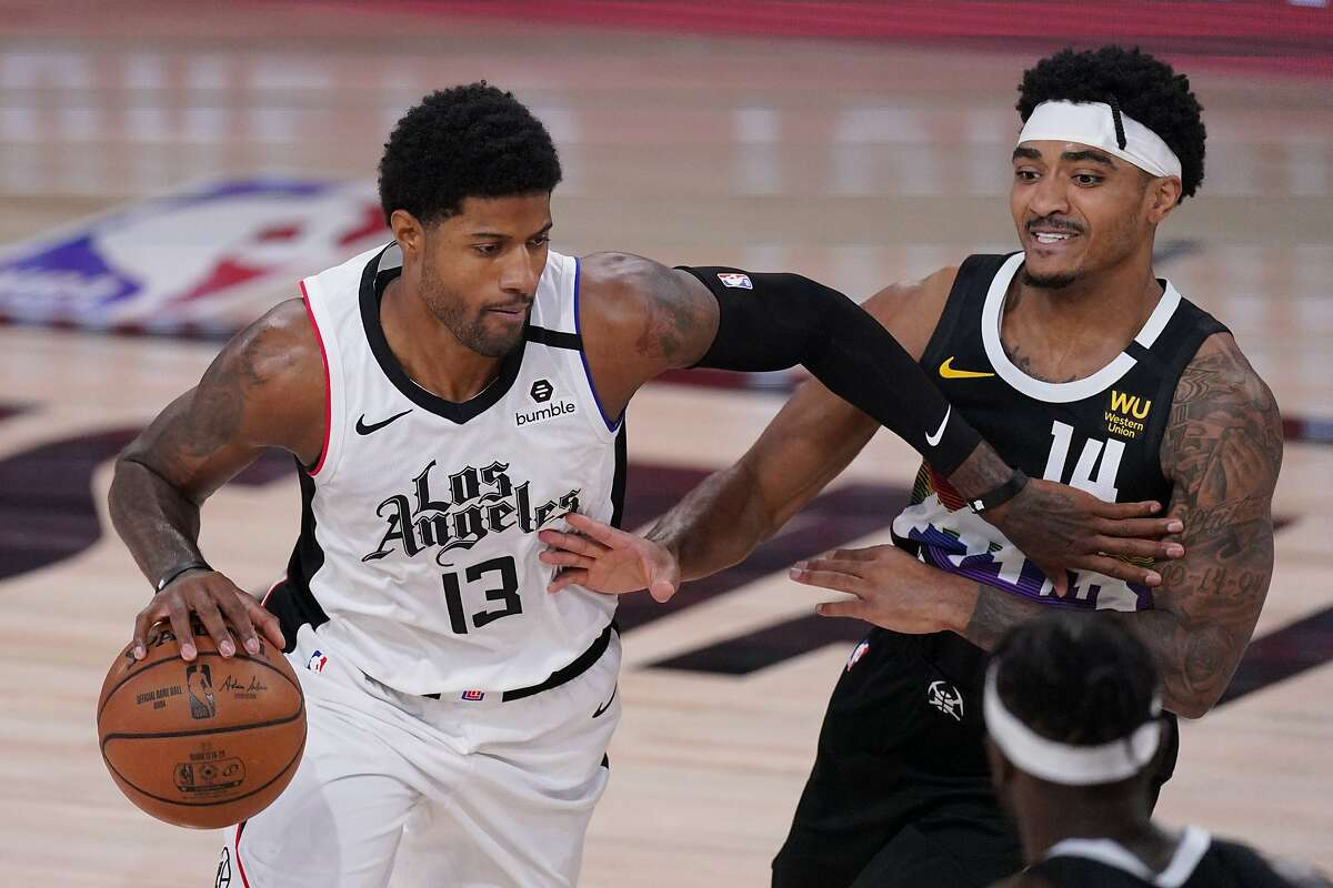 Los Angeles Clippers' Paul George (13) drives past Denver Nuggets' Gary Harris (14) during the first half of an NBA conference semifinal playoff basketball game Monday, Sept. 7, 2020, in Lake Buena Vista, Fla. (AP Photo/Mark J. Terrill)