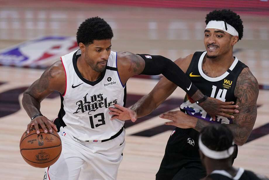 Los Angeles Clippers' Paul George (13) drives past Denver Nuggets' Gary Harris (14) during the first half of an NBA conference semifinal playoff basketball game Monday, Sept. 7, 2020, in Lake Buena Vista, Fla. (AP Photo/Mark J. Terrill) Photo: Mark J. Terrill / Associated Press