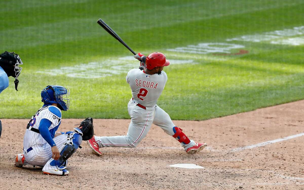 Jean Segura #2 of the Philadelphia Phillies follows through on his tenth inning two-run home run against the New York Mets at Citi Field on Sept. 7, 2020 in New York City. The Phillies won, 9-8. (Jim McIsaac/Getty Images/TNS)