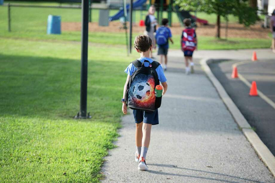 Connecticut has a established a metric based on the average weekly number of new COVID-19 cases and hospitalization rates to determine whether schools should switch to distance learning. Photo: Bryan Haeffele / Hearst Connecticut Media