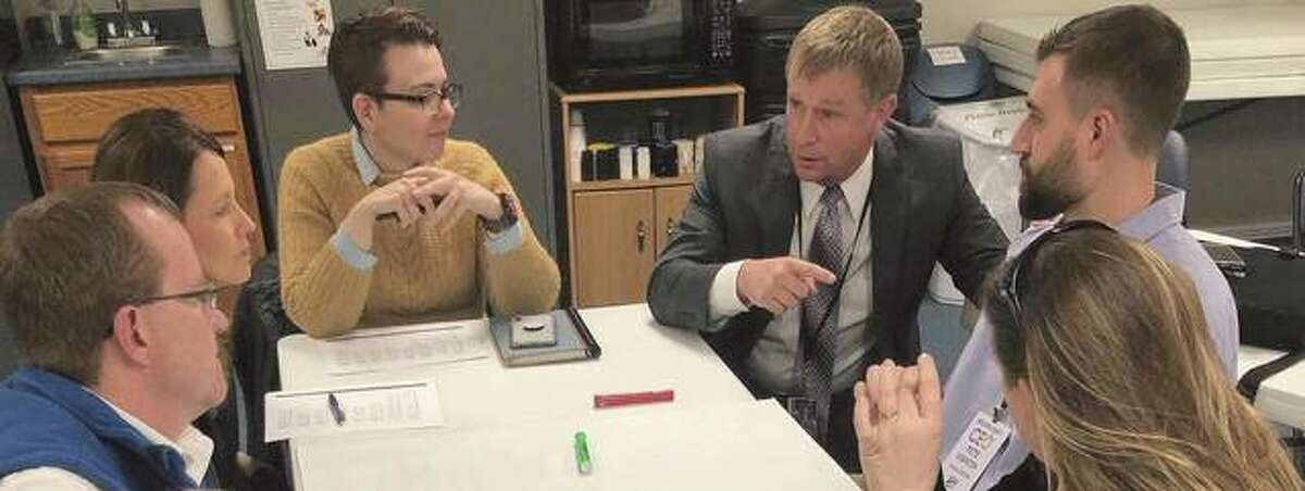 Todd Dugan (from left) of the Bunker Hill School District, Tonya Flannery representing the city of Litchfield, Elizabeth Nyman board director of Farmfront, Brad Tuttle from the Jersey school district, Macoupin County CEO Pete Visintin and Kendra Wright of Imagine Hillsboro engage in a conversation.