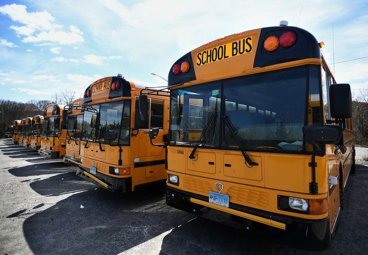 School buses are parked in neat rows at the Trumbull school bus depot at 81 Spring Hill Road in Trumbull, Conn. on Wednesday, April 1, 2020.