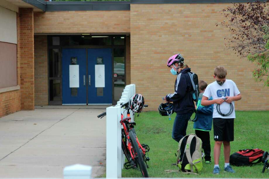 Children arrive by bike for their first day back at Crystal Lake Elementary School. (Photo/Colin Merry)