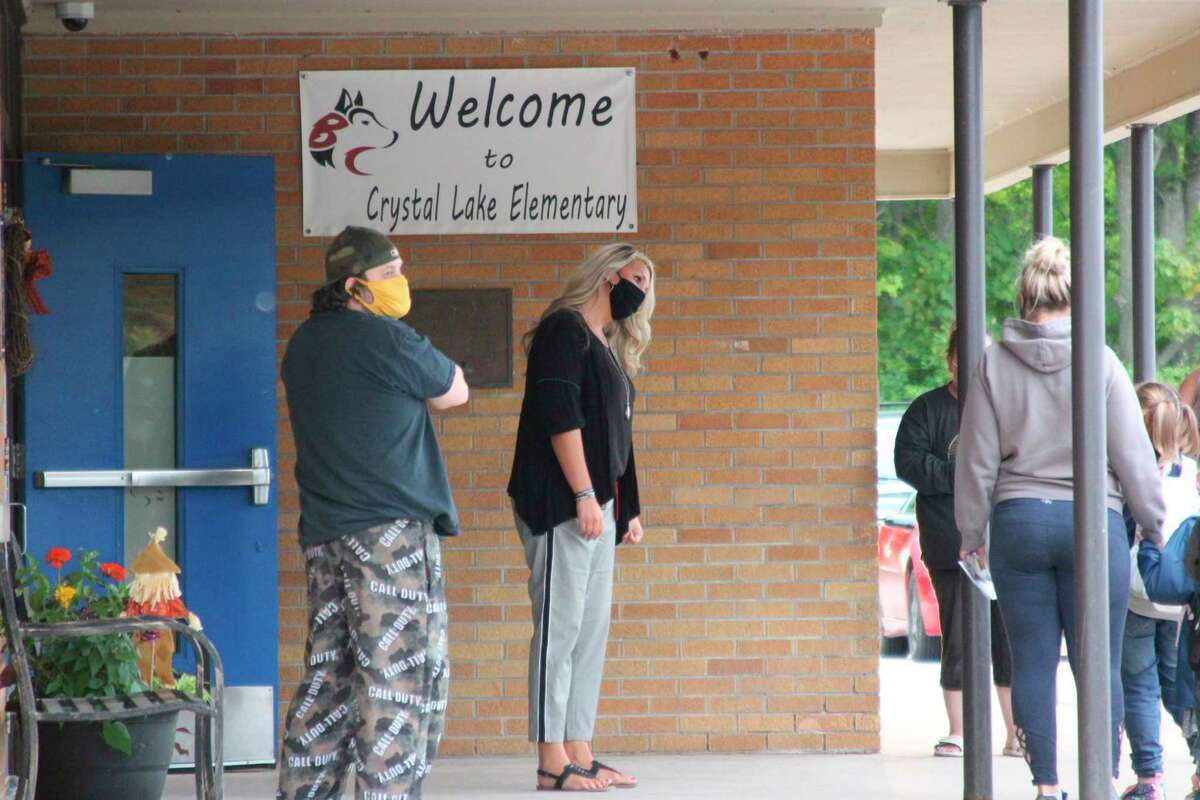 Crystal Lake Elementary School Principal Brooke Casper greets students returning to school on Tuesday. (Photo/Colin Merry)