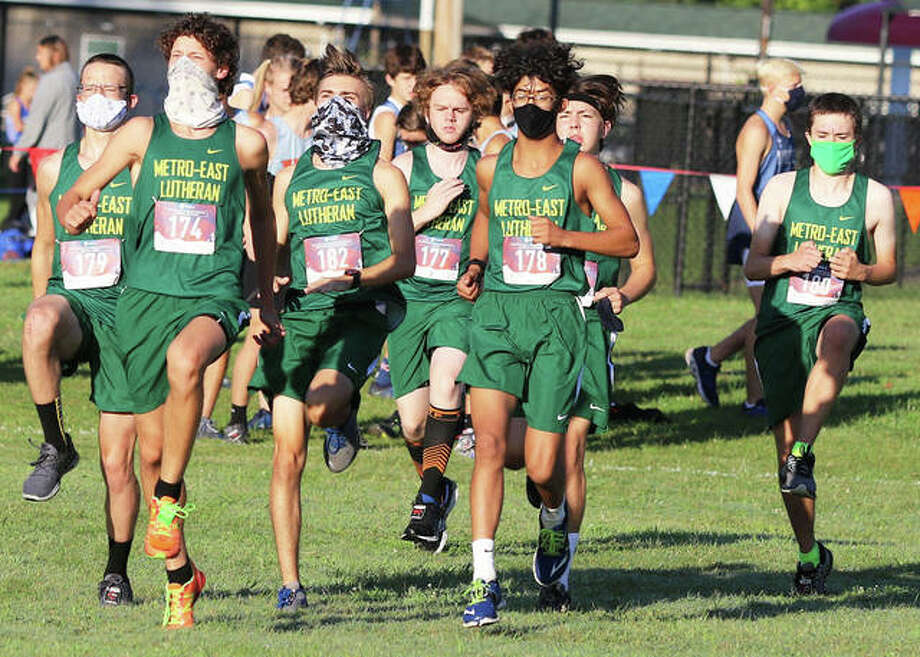 The Metro-East Lutheran boys team warms up before Saturday's Granite City Invitational cross country meet at Wilson Park. A couple dozen schools and 301 runners, split into six races, competed in the event. Photo: Greg Shashack / The Telegraph