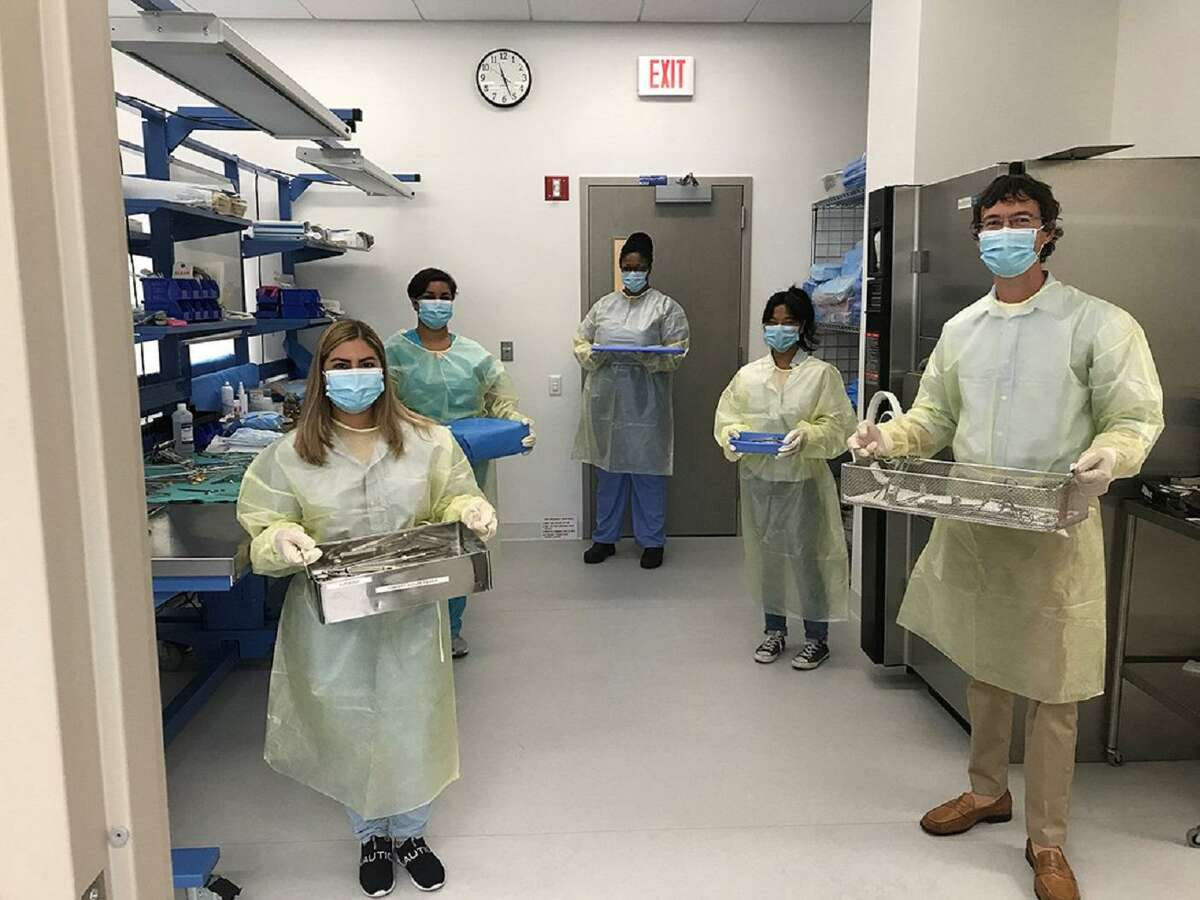 Sterile processing technician students learn hands-on skills at Housatonic Community College's sterilization simulation lab.