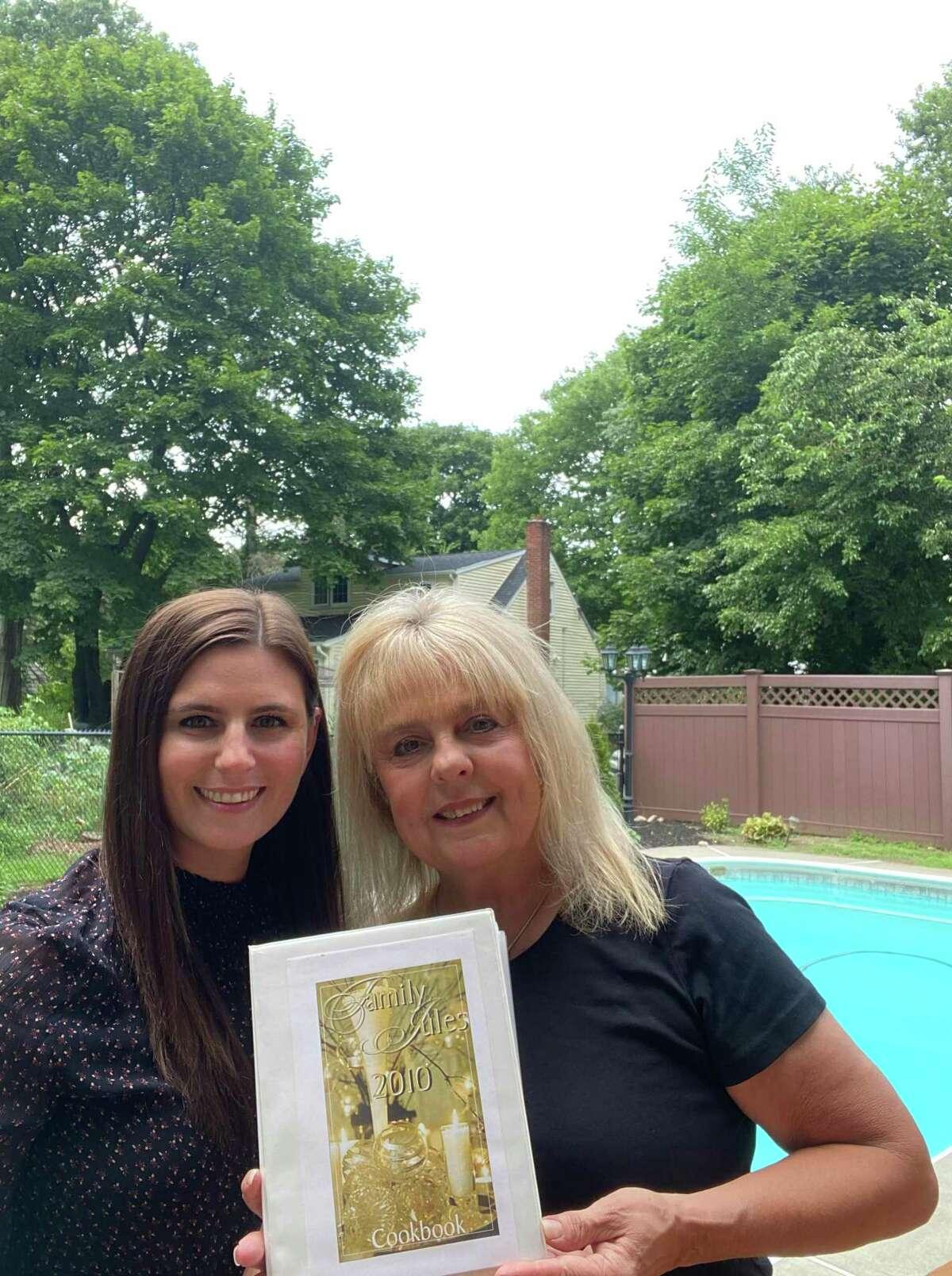 Julie Miller and her daughter Jordan pose with a copy of