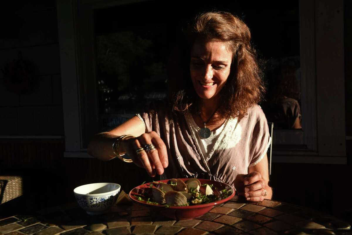 Caroline Barrett prepares her pasta with white clam sauce dish on Thursday, Sept. 3, 2020, at her home in Delmar, N.Y. (Will Waldron/Times Union)