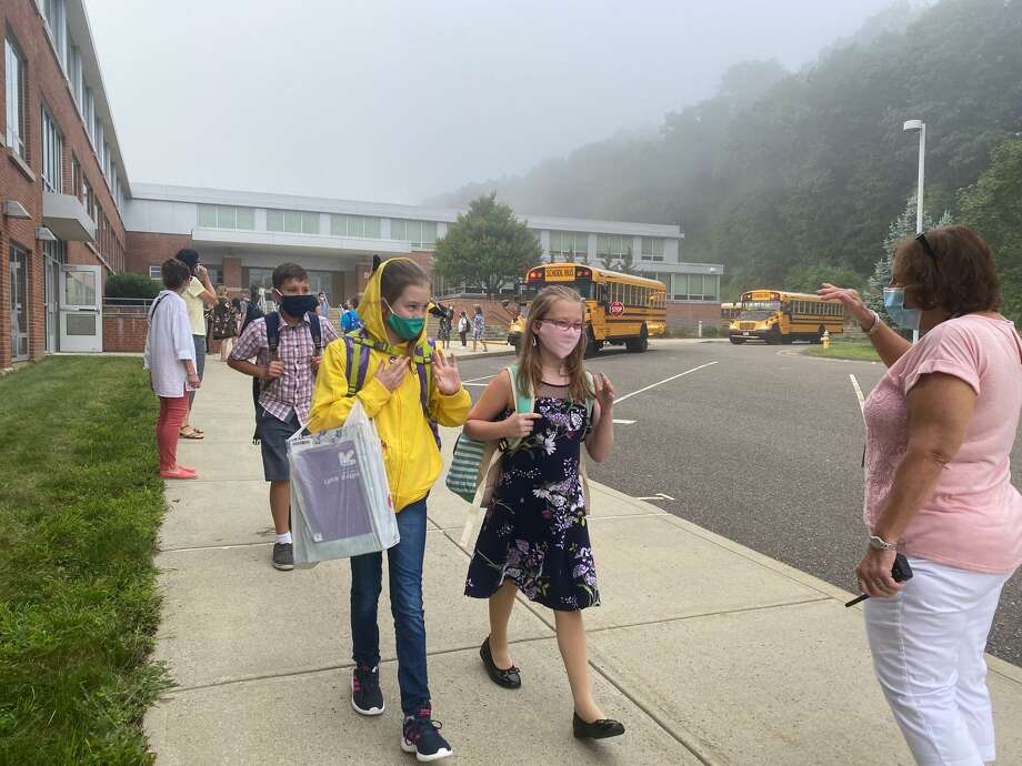 Students are welcomed back at Perry Hill School Tuesday. Photo: Brian Gioiele / Hearst Connecticut Media / Connecticut Post