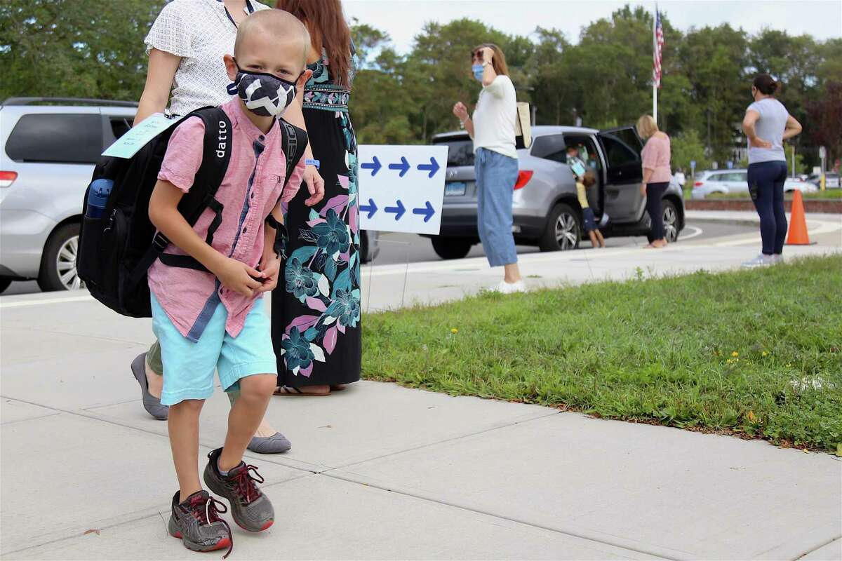 Robert Gibbons, III, 7, heads into school for the start of second grade at Miller-Driscoll on Sept. 8, 2020, in Wilton, Conn.