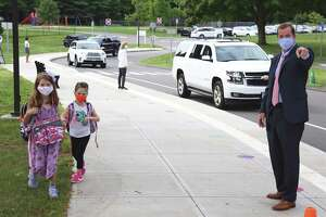 Superintendent of School Kevin Smith directs two students into school for their first day of in-person class at Miller-Driscoll on Sept. 8. Enrollment has declined by 125 students as of October Smith recently told the Board of Education.