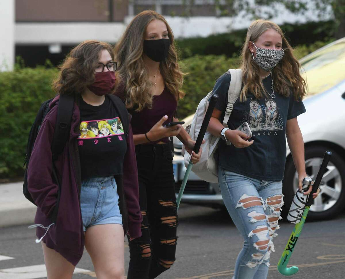 Students enter school on the first day of the 2020-2021 school year at Stamford High School in Stamford, Conn. Tuesday, Sept. 8, 2020. As a coronavirus precaution, students will be split into two groups to attend classes every other day. On days when they are not physically in class, students will learn remotely.