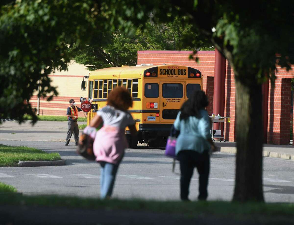 Students enter school on the first day of the 2020-2021 school year at Westover Elementary School in Stamford, Conn. Tuesday, Sept. 8, 2020. As a coronavirus precaution, students will be split into two groups to attend classes every other day. On days when they are not physically in class, students will learn remotely.