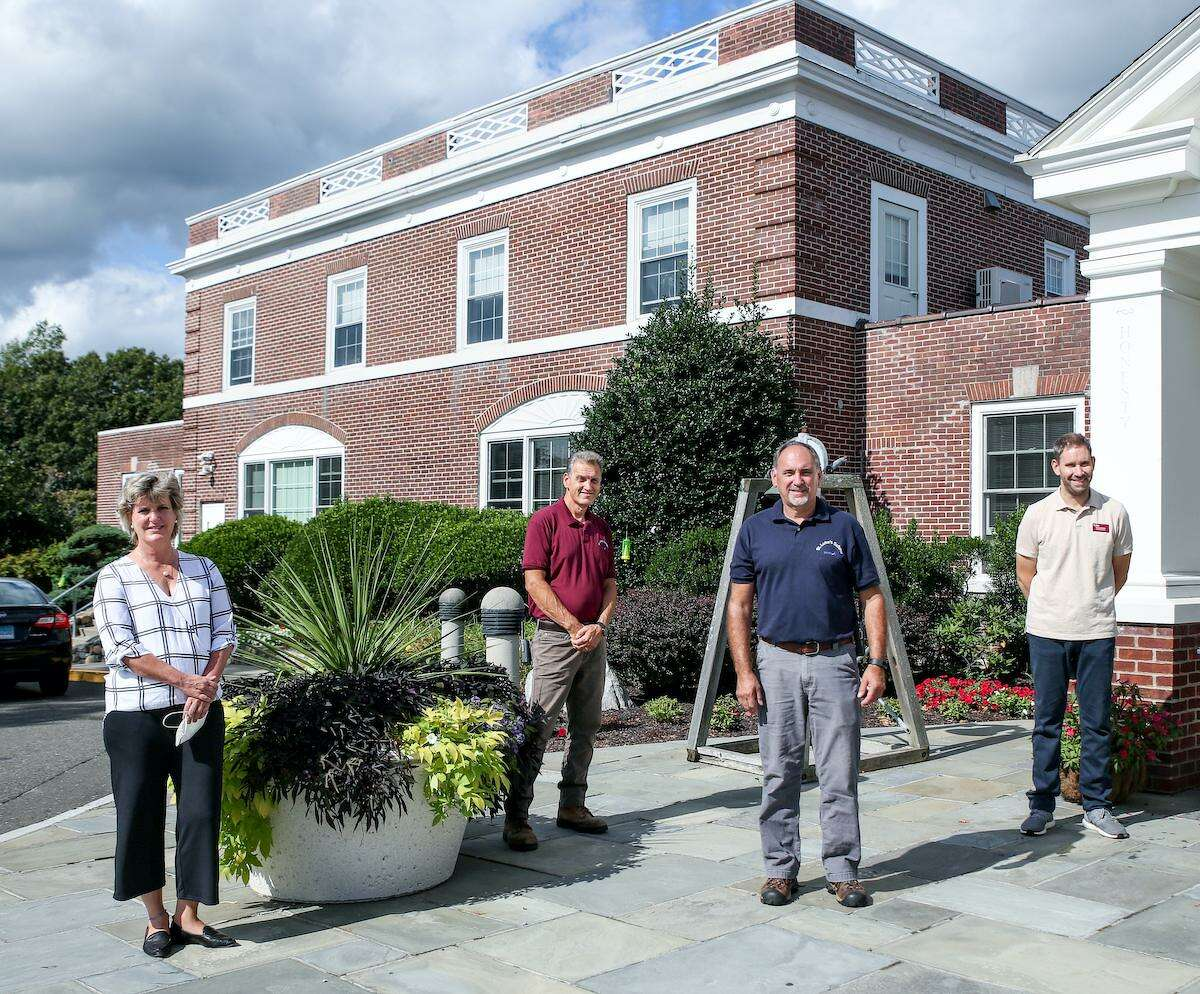 Julia Gabriele, associate head of school & chief financial officer; Rich Kaechele, facilities technician; John Tita, facilities technician; and Mike Mitchell, designLab director in front of the newly installed parapets at St. Luke's School in New Canaan.