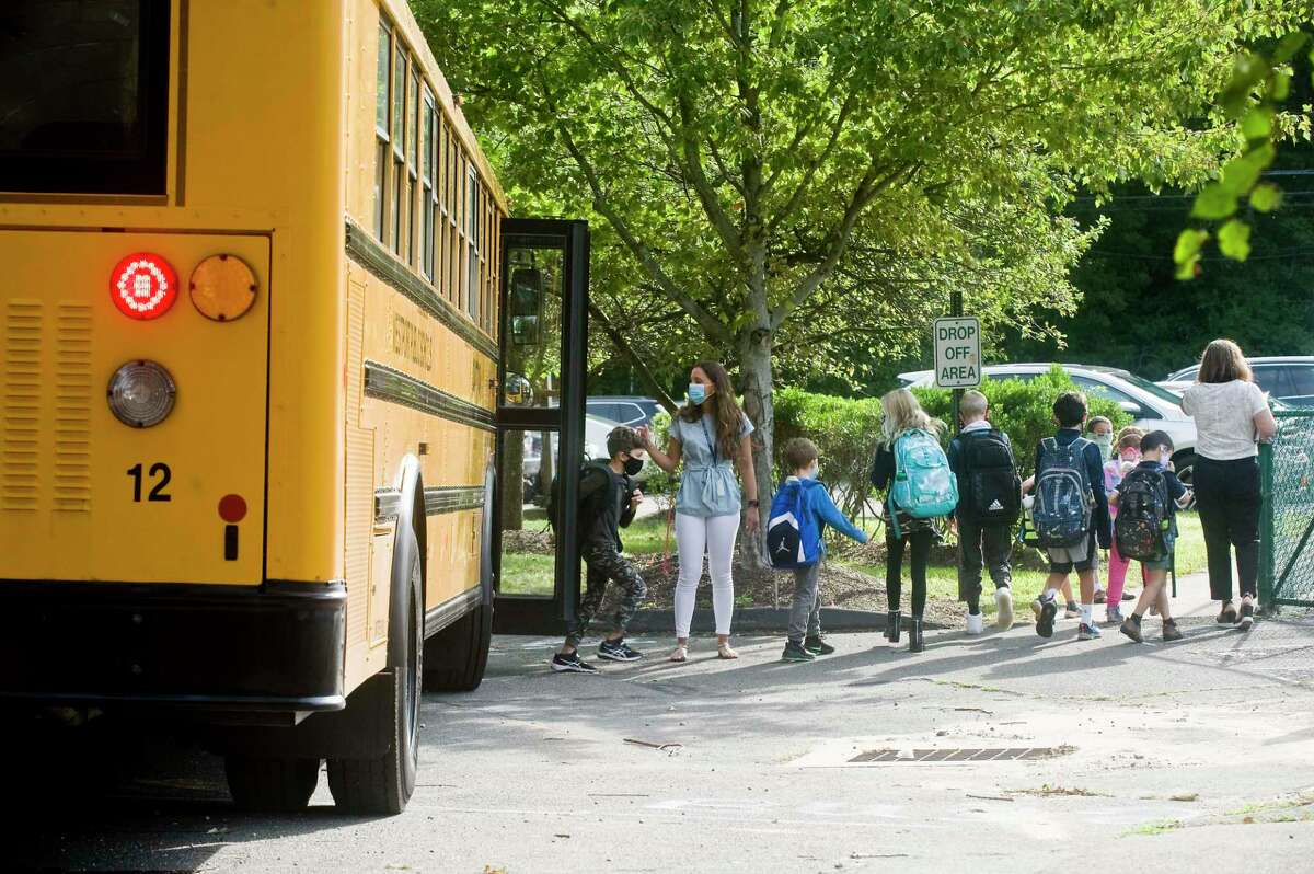 Kids arrive for the first day of school at Coleytown Elementary School. Tuesday, Sept. 8, 2020