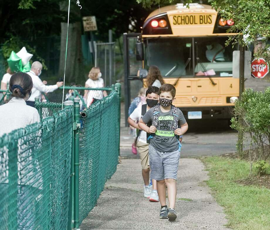 Kids arrive for the first day of school at Coleytown Elementary School. Tuesday, Sept. 8, 2020 Photo: Scott Mullin / For Hearst Connecticut Media / The News-Times Freelance