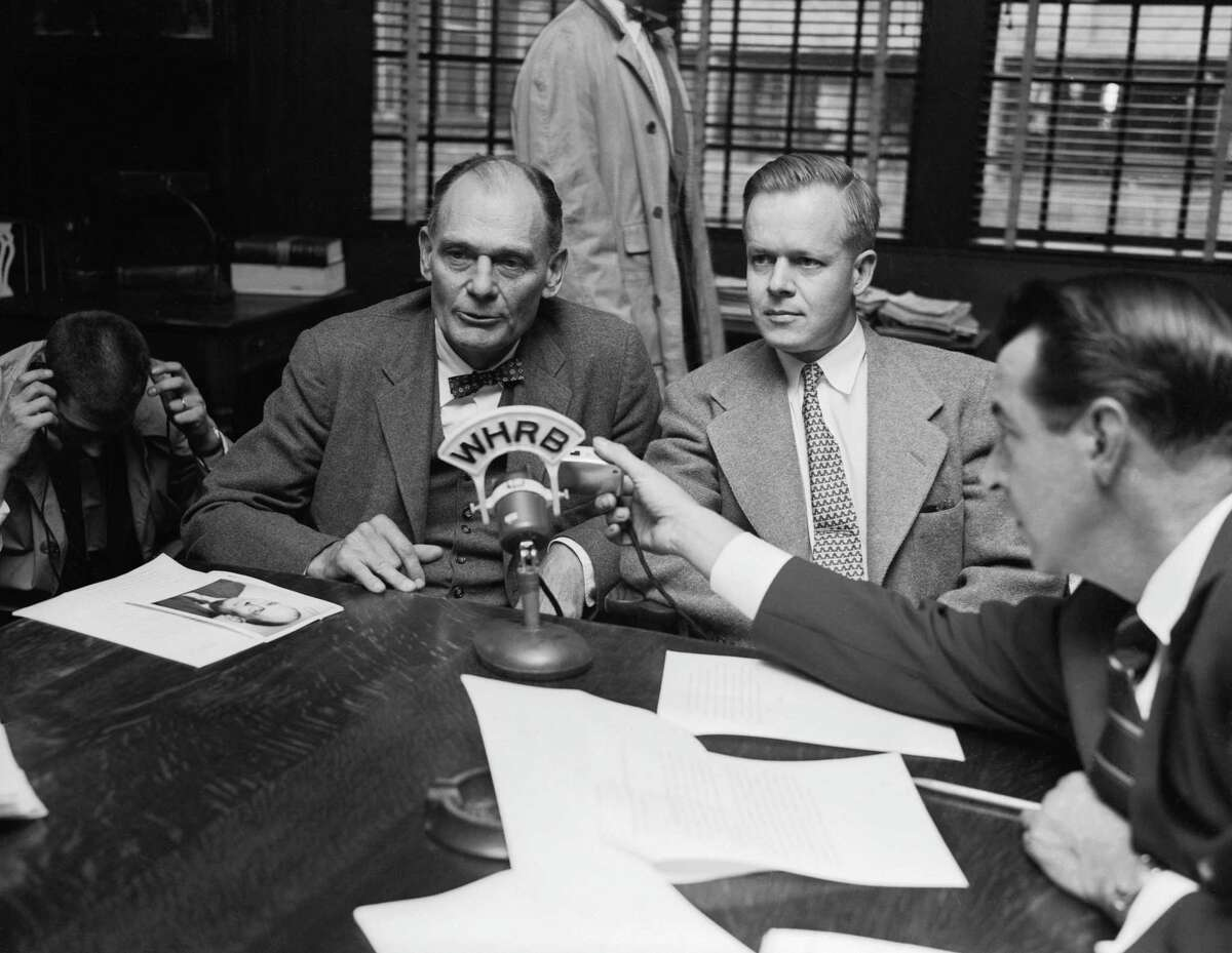 Dr. John Enders (left) tells a press conference at the Children's Medical Center that his Nobel Prize winning research paved the way for early development of a polio vaccine. Dr. Enders, co-winner of the 1954 Nobel Prize in medicine with Dr. Thomas H. Weller (right) and Frederick C. Robbins, developed a successful method of growing polio virus in human tissue. He says he and his two fellow scientists are now looking for a new polio vaccine, and they expect to have it soon.
