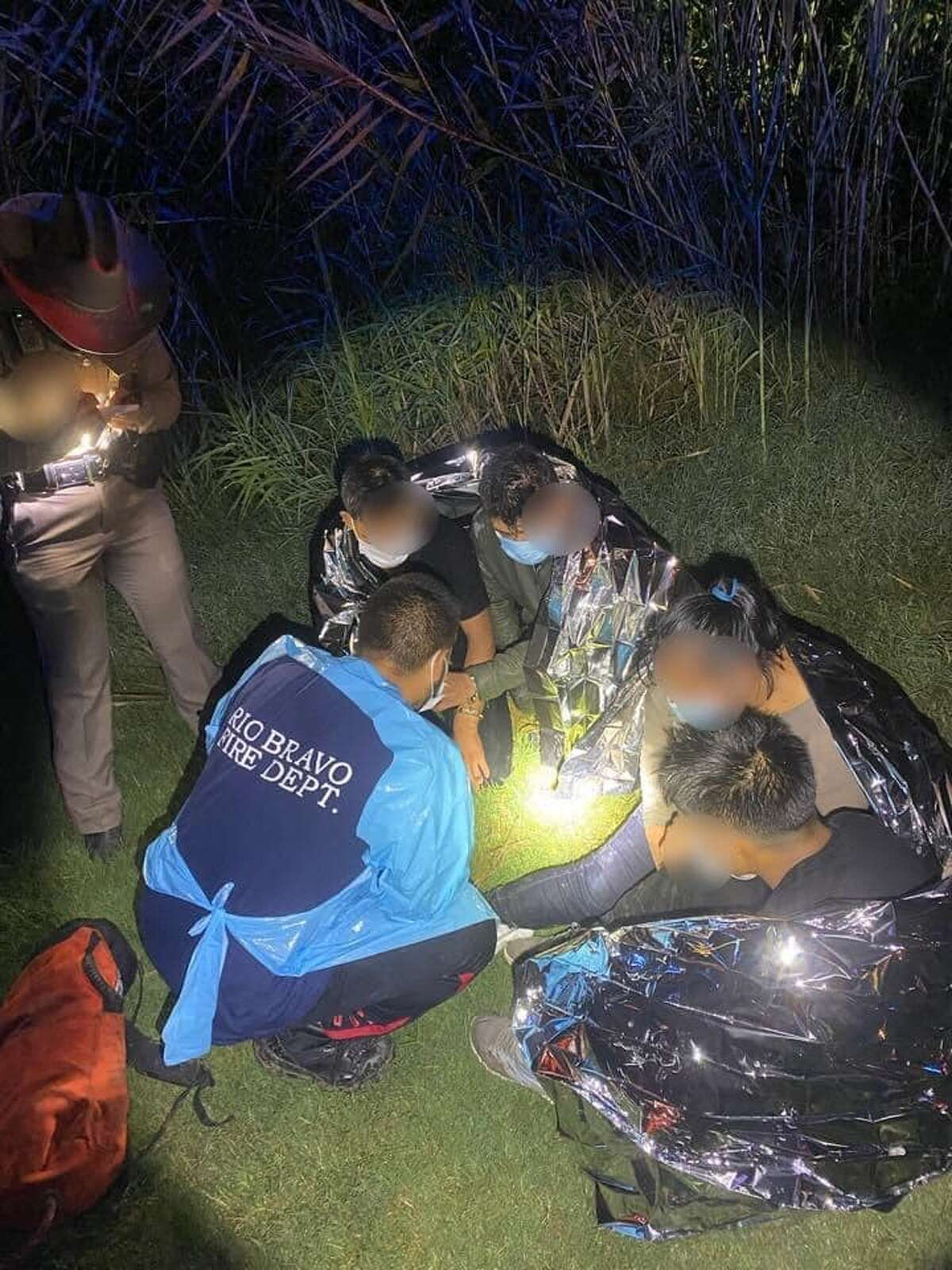 First responders are seen rendering aid to four immigrants who were rescued from a sinking vehicle in El Cenizo. The suspected human smuggler drove his vehicle into the Rio Grande to avoid apprehension.