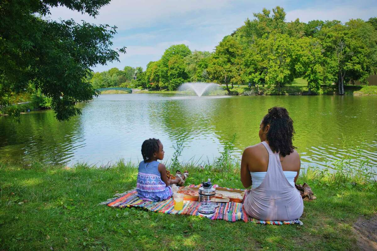 """Images from the past could look a lot like the future this week with forecasters predicting the temperature could hit the mid-60s by Thursday. In this photograph,Ashley Witty of Colonie has a """"mommy and me"""" date with her daughter, Valencia Fraser, 4, at Washington Park on Tuesday, Sept. 8, 2020, in Albany, N.Y. Witty said that she planned the special day with her daughter as she gets her prepared for the start of pre-k school on Wednesday. (Paul Buckowski/Times Union)"""