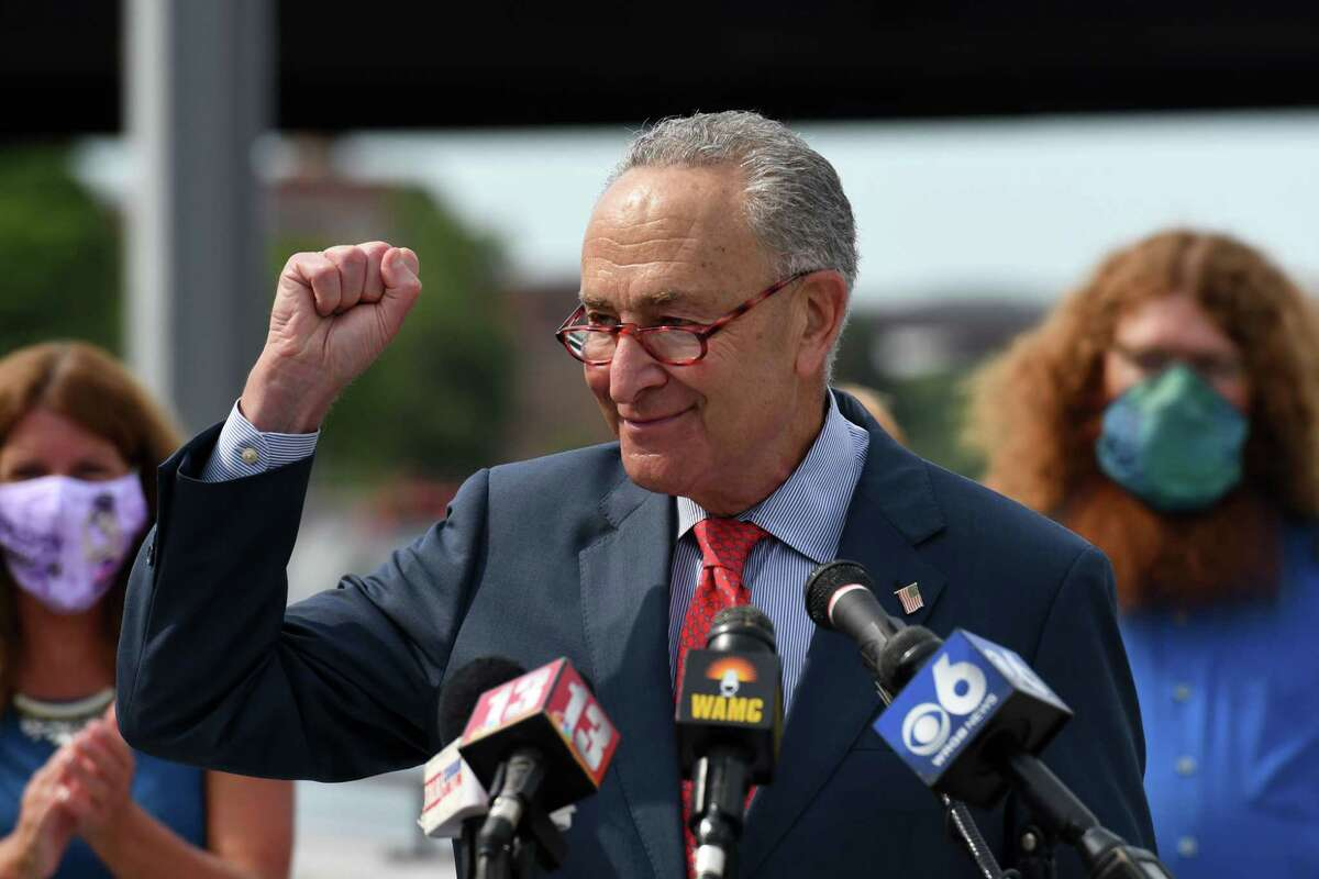 U.S. Sen. Charles Schumer raises an arm in celebration during an event to mark the completion of renovations to the Troy Seawall on Monday, Sept. 8, 2020, at Riverfront Park - North in Troy, N.Y. $14.5 million in federal funds were allocated for the Hudson River barrier and redeveloping of the city marina. The seawall was deemed a priority after Tropical Storm Irene flooded downtown areas in 2011. (Will Waldron/Times Union)