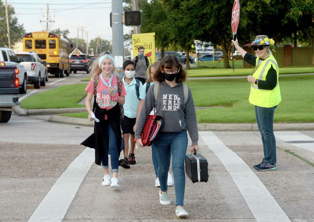 Crossing guard Janet Polk wore a special hat for the first day of school while assisting students safely make their way through traffic on the first day of classes in Nederland. Photo taken Tuesday, September 8, 2020 Kim Brent/The Enterprise