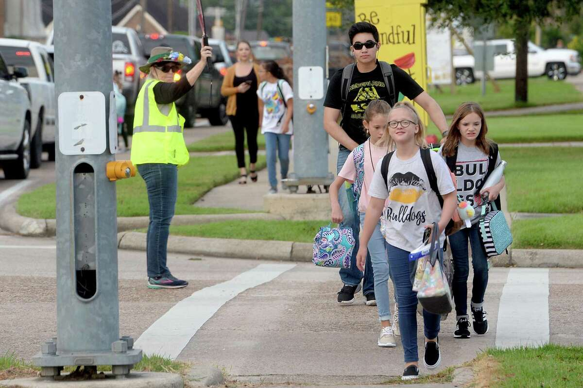 Janet Polk works the intersection at Helena and 27th Street as students make their way back to school on the first day of classes in Nederland. Photo taken Tuesday, September 8, 2020 Kim Brent/The Enterprise