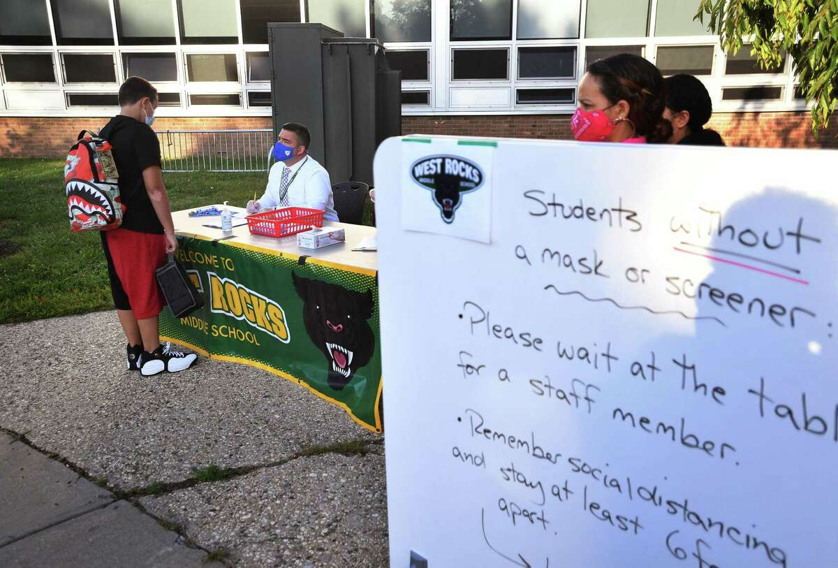 Students arrive at check in for the first day of classes at West Rocks Middle School in Norwalk, Conn. on Tuesday, September 8, 2020. West Rocks was put on remote learning on Dec. 11, 2020 to allow for contact tracing after a COVID case was reported there.