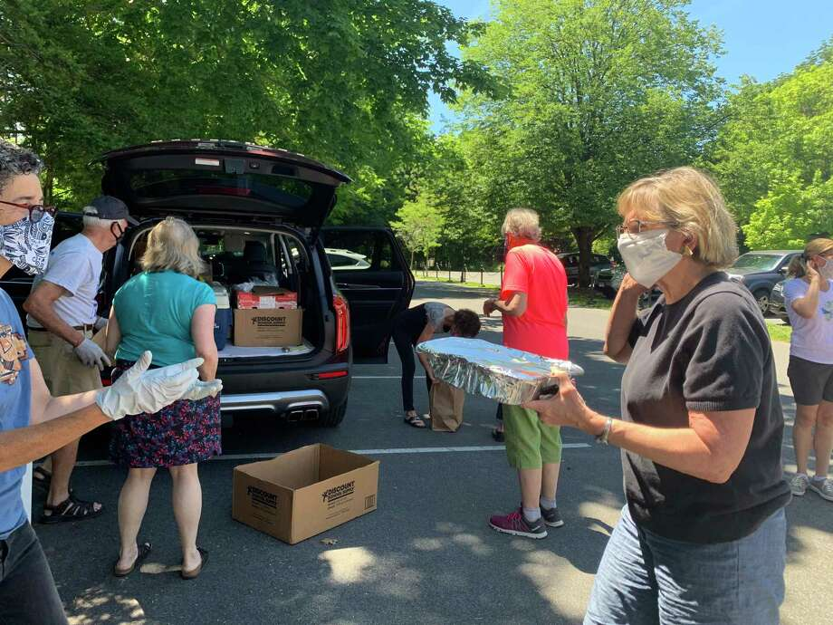 FCC volunteers collecting homemade dishes for the Pot Luck For Pivot. Photo: Contributed / First Congregational Church Of Ridgefield