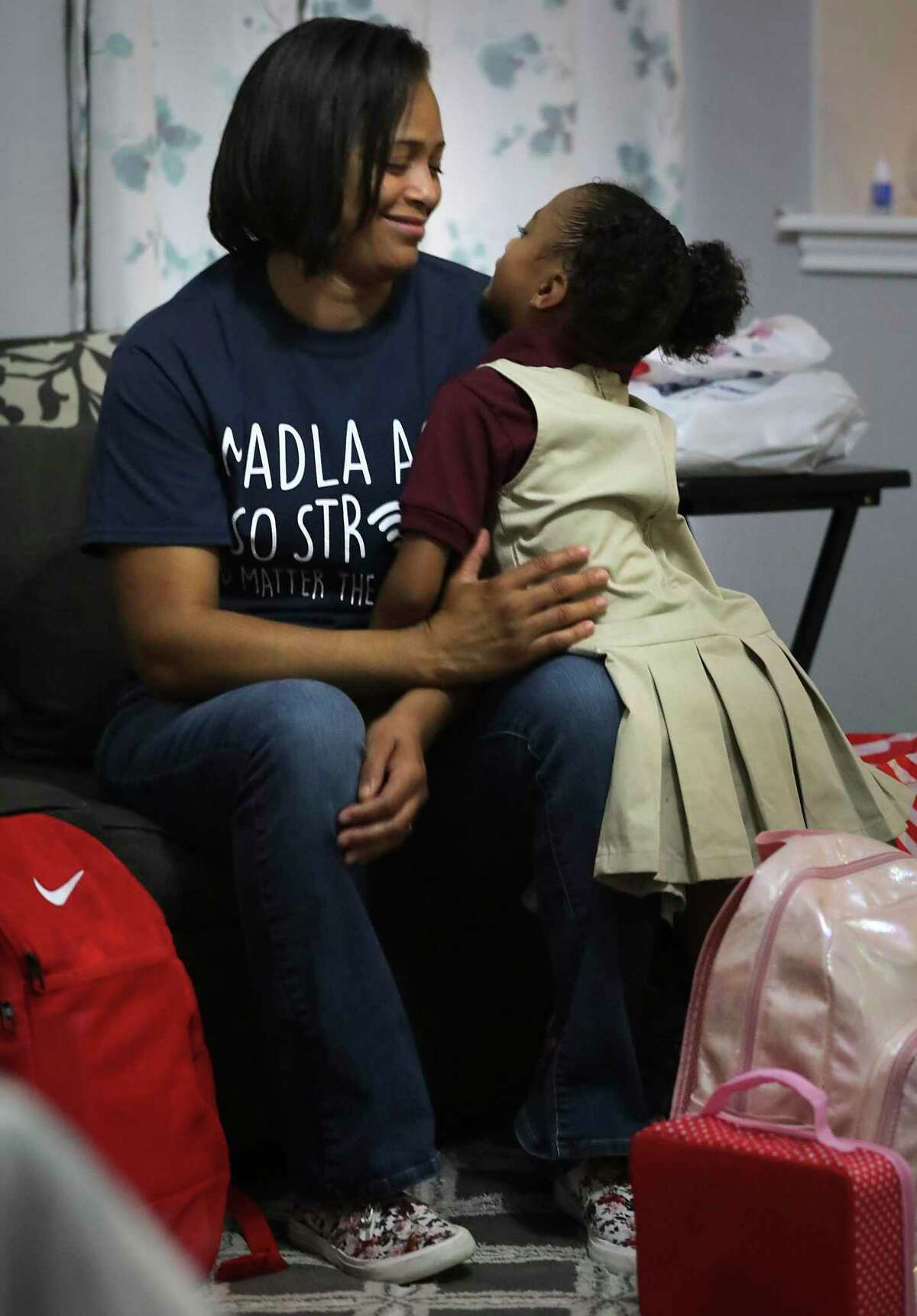 With her backpack full of school supplies, Alyssa Nolasco, 5, gives her mother Danyal Nolasco a loving hug as they prepare for their first in-person day of school Tuesday at Frank L. Madla Accelerated Collegiate Academy.