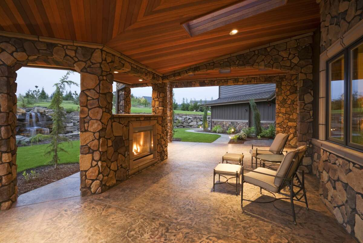 Bring the indoors out, asks luxury home buyers, with elements like outdoor fireplaces and upholstered furniture.
