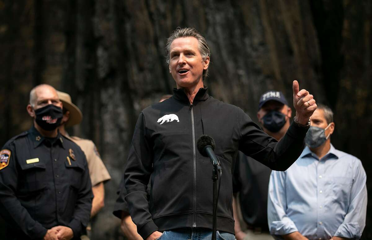 """Gov. Gavin Newsom, shown viewing fire damage at Big Basin Redwoods State Park, hopes to """"future-proof"""" the state."""