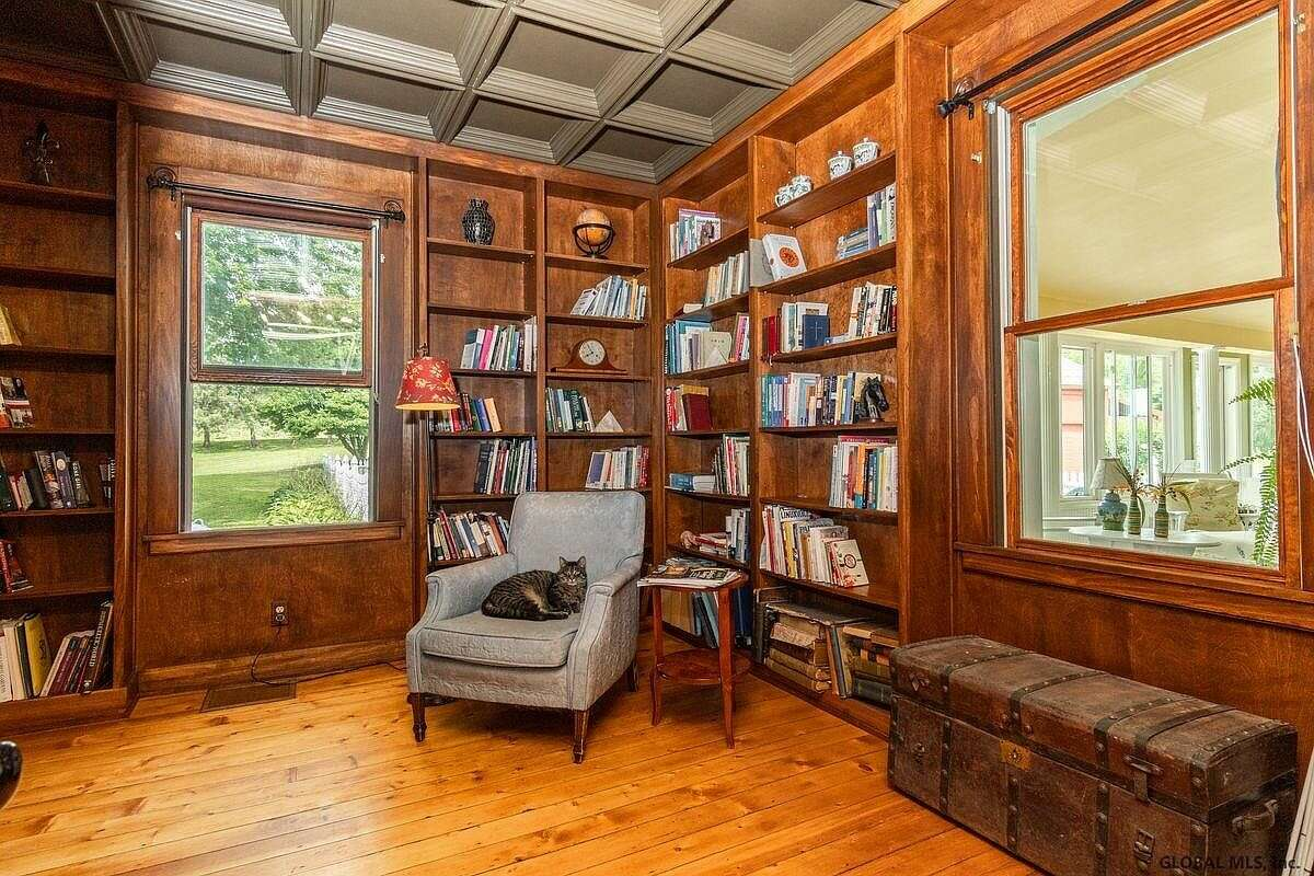Scroll through the following photos to take a look inside five Capital Region homes for sale with stunning personal libraries.