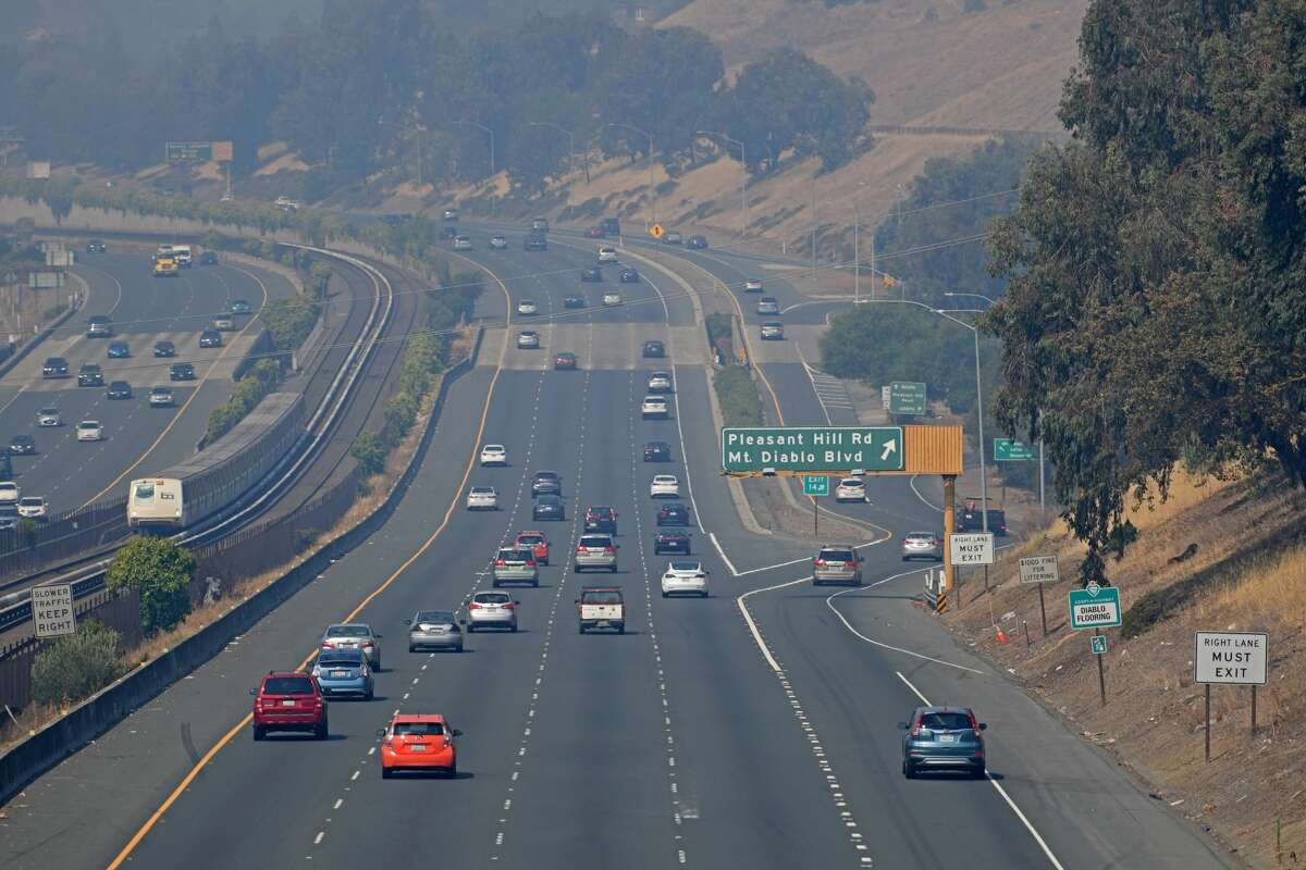 FILE PHOTO: Traffic on Highway 24 moves smoothly as motorist travel through a thick cloud of smoke in Lafayette, Calif., on Saturday, Aug. 22, 2020.