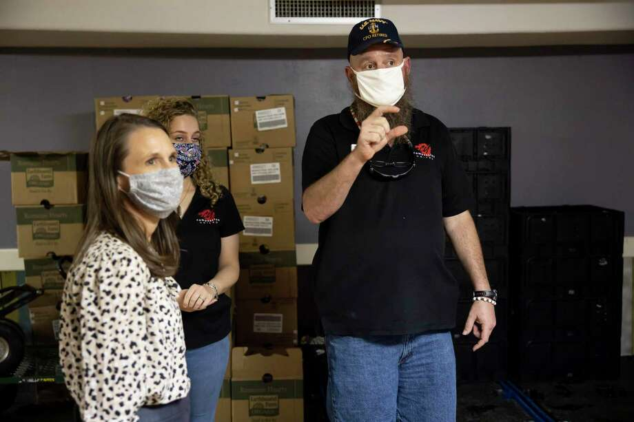 Paul Collom, right, explains how Compassion United's food pantry operates to Kristine Marlow, CEO and president of the Montgomery County Food Bank, Friday, Sept. 4, 2020, in Conroe. The grant will allow the non-profit to purchase and install a walk-in cooler. Photo: Gustavo Huerta, Houston Chronicle / Staff Photographer / 2020 © Houston Chronicle