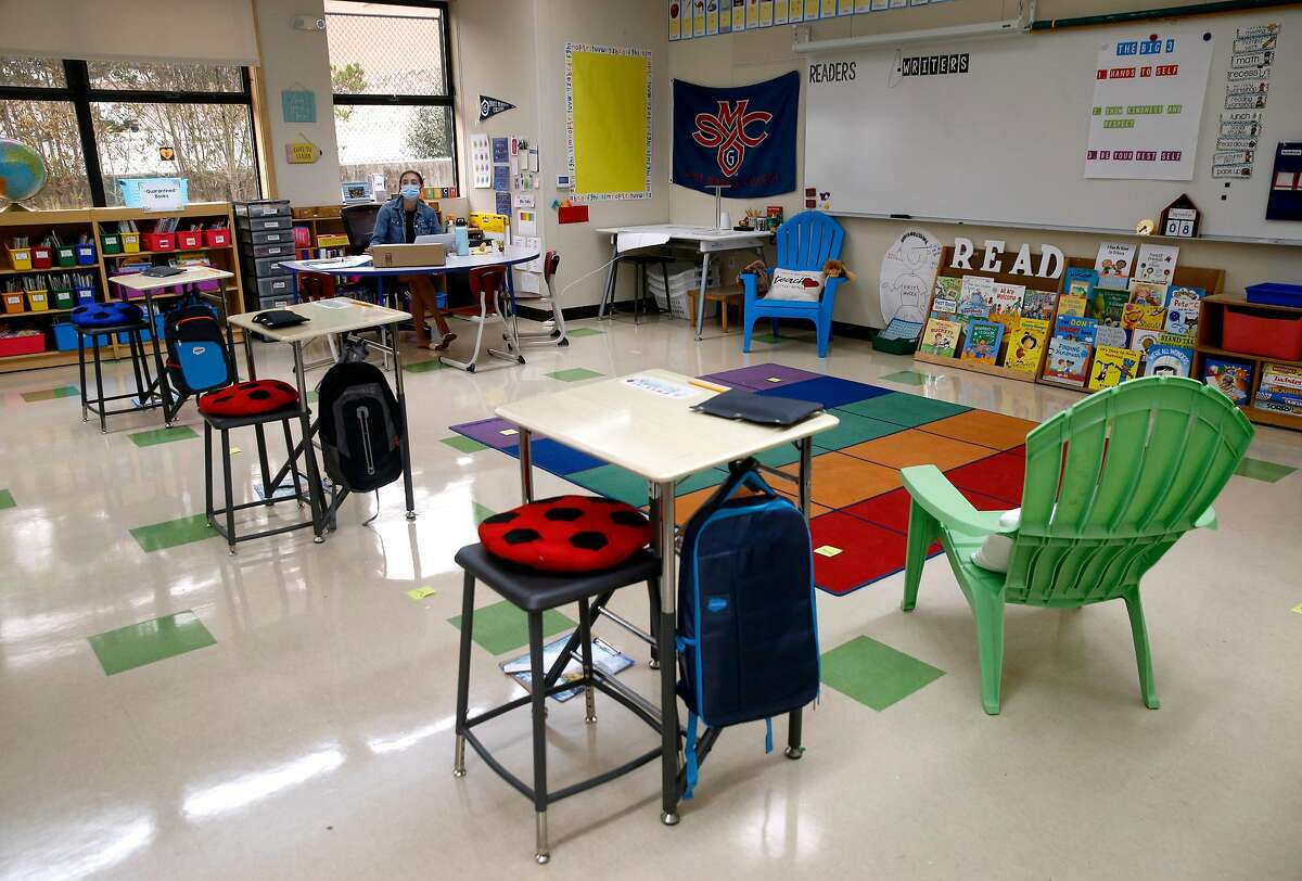 Desks in Samantha Kelly'€™s 1st grade classroom are spaced at least six feet apart at Bayside Martin Luther King Jr. Academy in Sausalito, Calif. on Tuesday, Sept. 8, 2020. The K-8 school was anticipating opening to in-class learning Tuesday but a potential positive test of the COVID-19 virus of a staff member delayed the opening for at least one week.