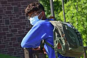 A student waits for his ride home after Rensselaer School District conducted their first day of classes on Tuesday, Sept. 8, 2020 in Rensselaer, N.Y. (Lori Van Buren/Times Union)