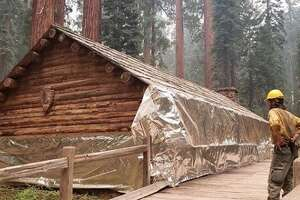 A structure in the southern portion of Yosemite National Park is wrapped with fire-resistant material as a fire precaution, just in case the Creek Fire enters the park.