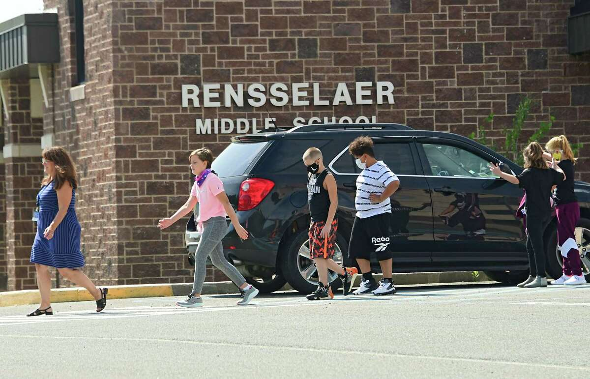 A teacher is seen leading a class of children from the Rensselaer Middle School on Tuesday, Sept. 8, 2020 in Rensselaer, N.Y. (Lori Van Buren/Times Union)