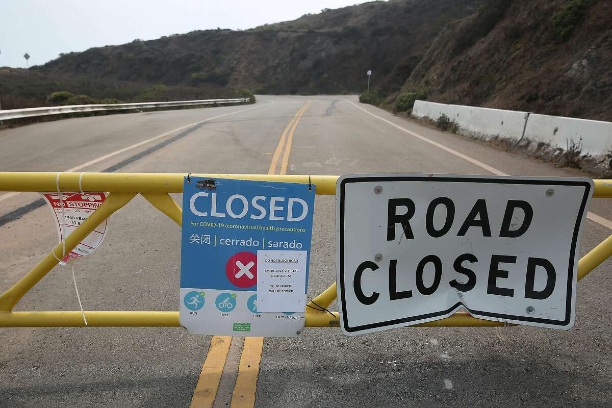 Signs at the road closure on Twin Peaks Boulevard are seen on Monday, August 31, 2020 in San Francisco, Calif.